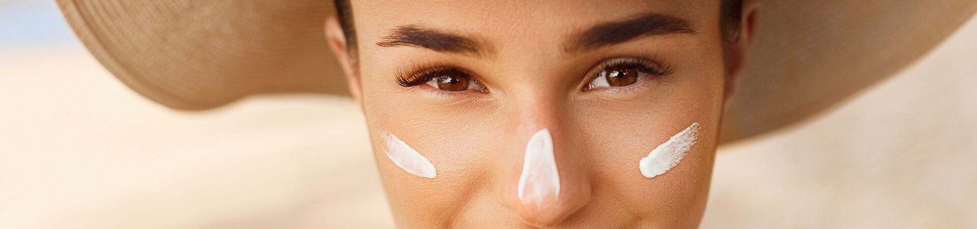 woman with moisturizer on face
